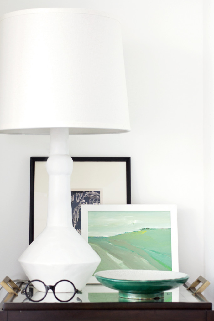 nightstand with white lamp + artwork via Anne Sage