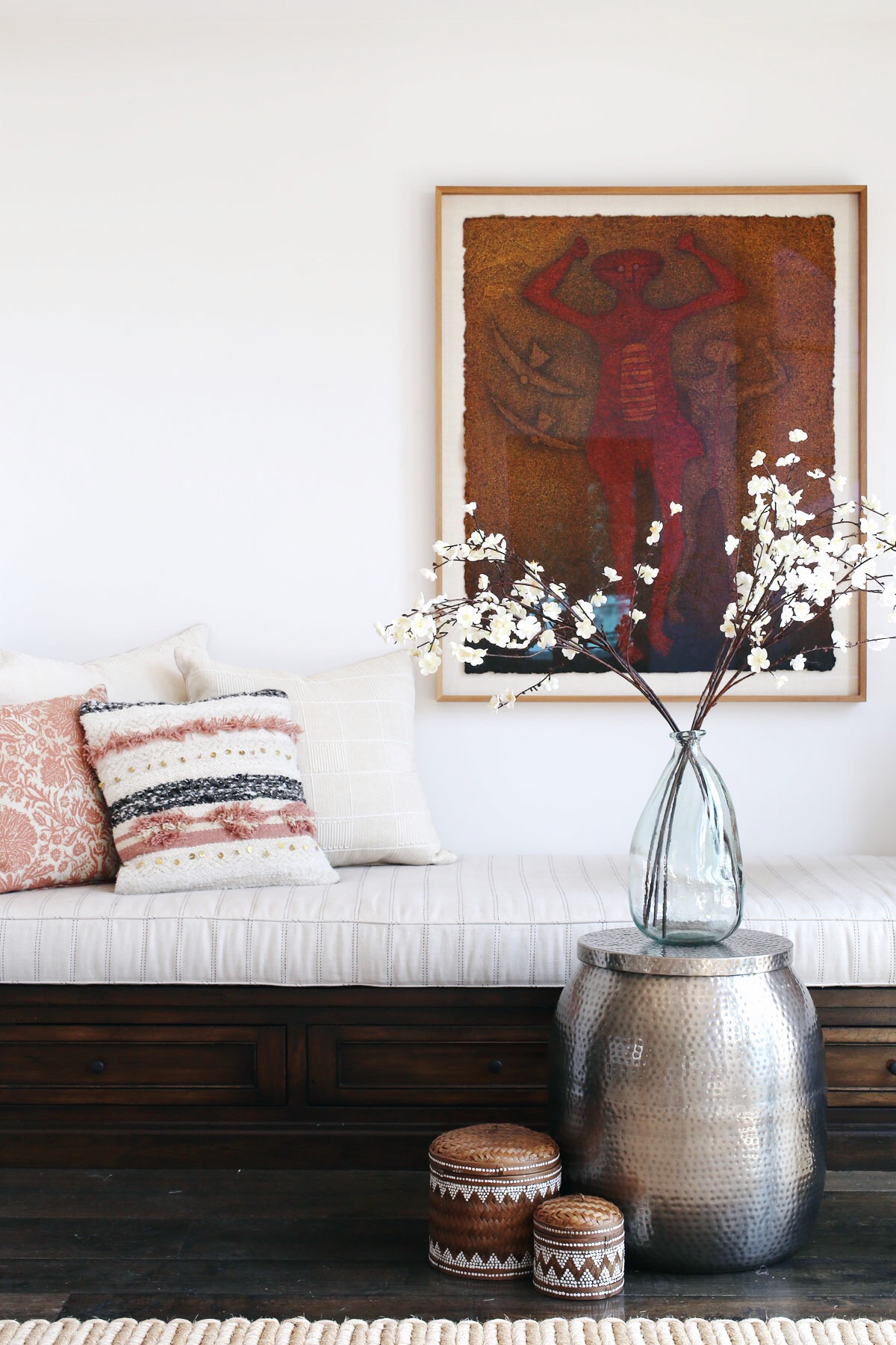 built-in seating with moroccan wedding blanket pillow via @citsage