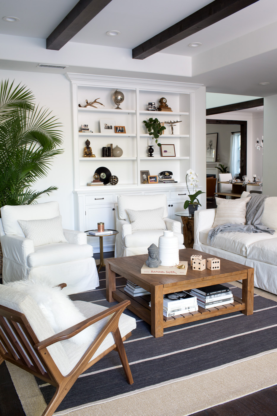 white, black, and wood living room with shelf styling via @citysage