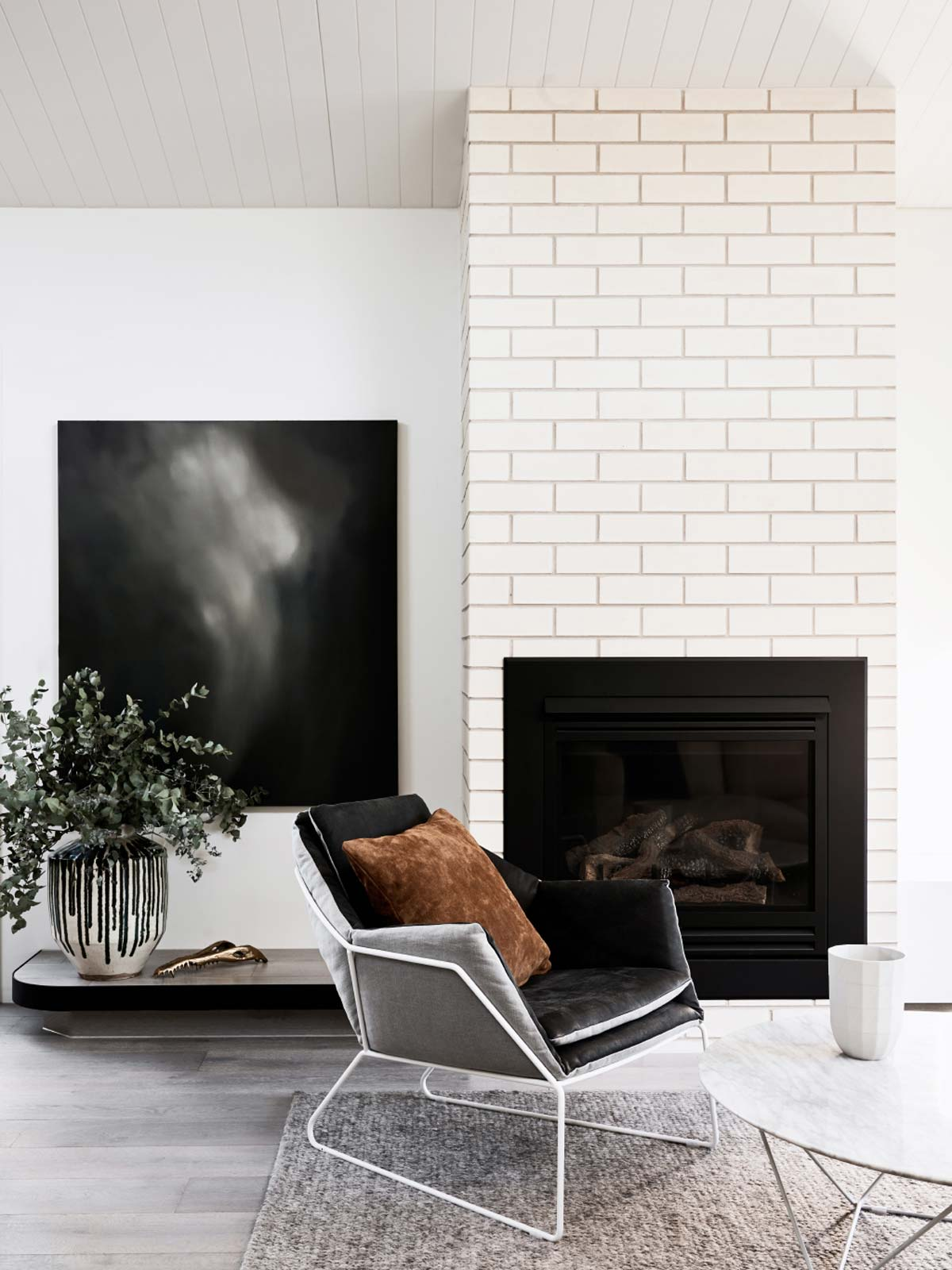 minimalist living room with grey velvet chair