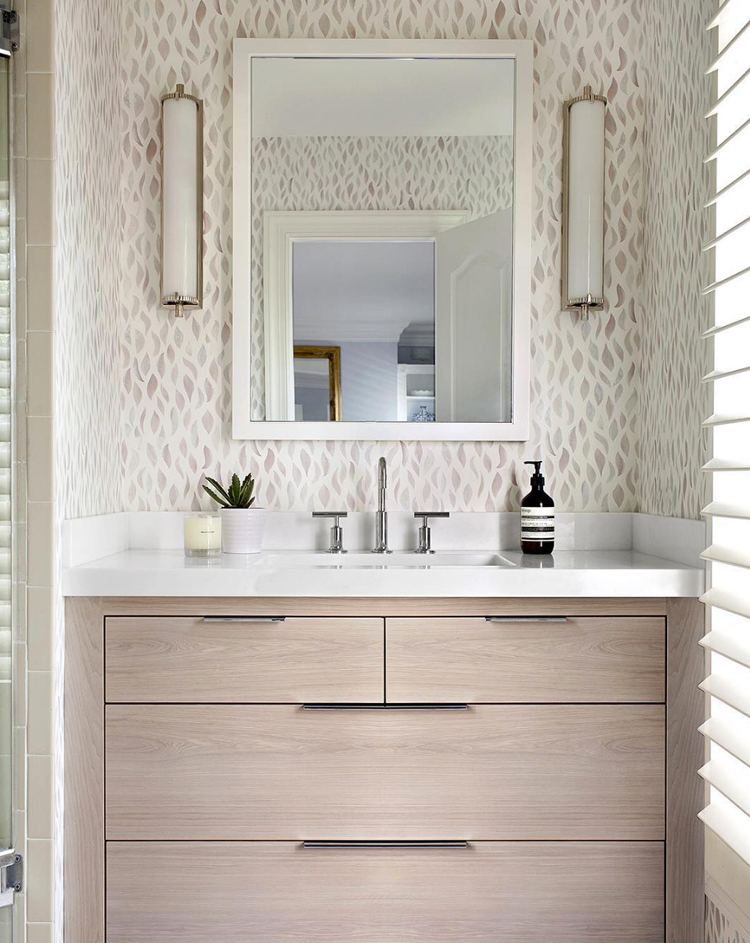 modern feminine bathroom with patterned wallpaper via @citysage