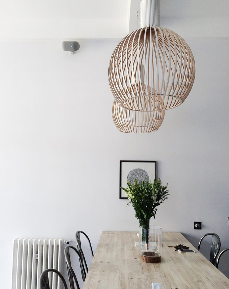 modern dining room with wood pendants and bentwood chairs via @citysage