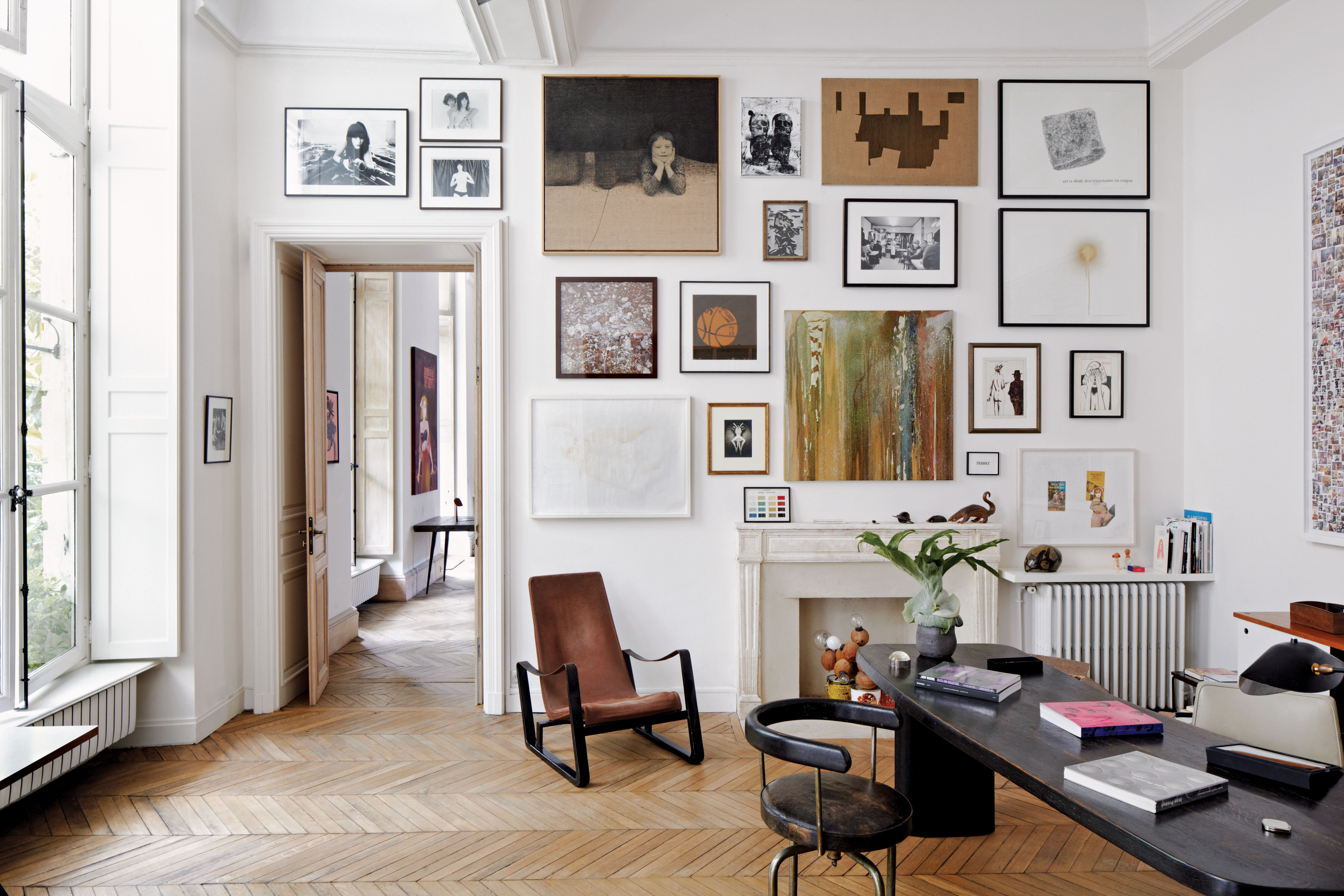 amazing gallery wall in an eclectic modern home office