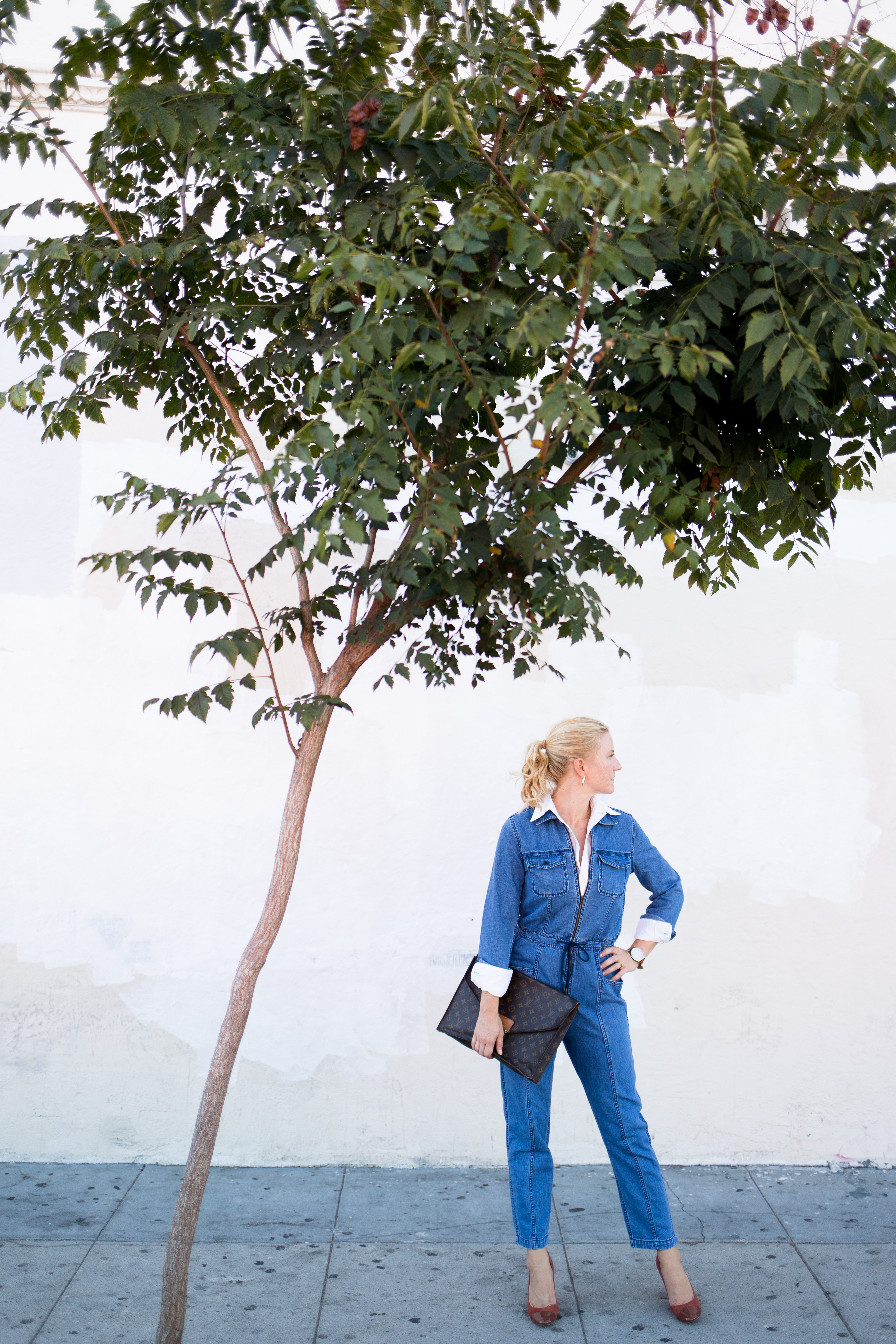 layer a white shirt under a denim jumpsuit for fall // anne sage
