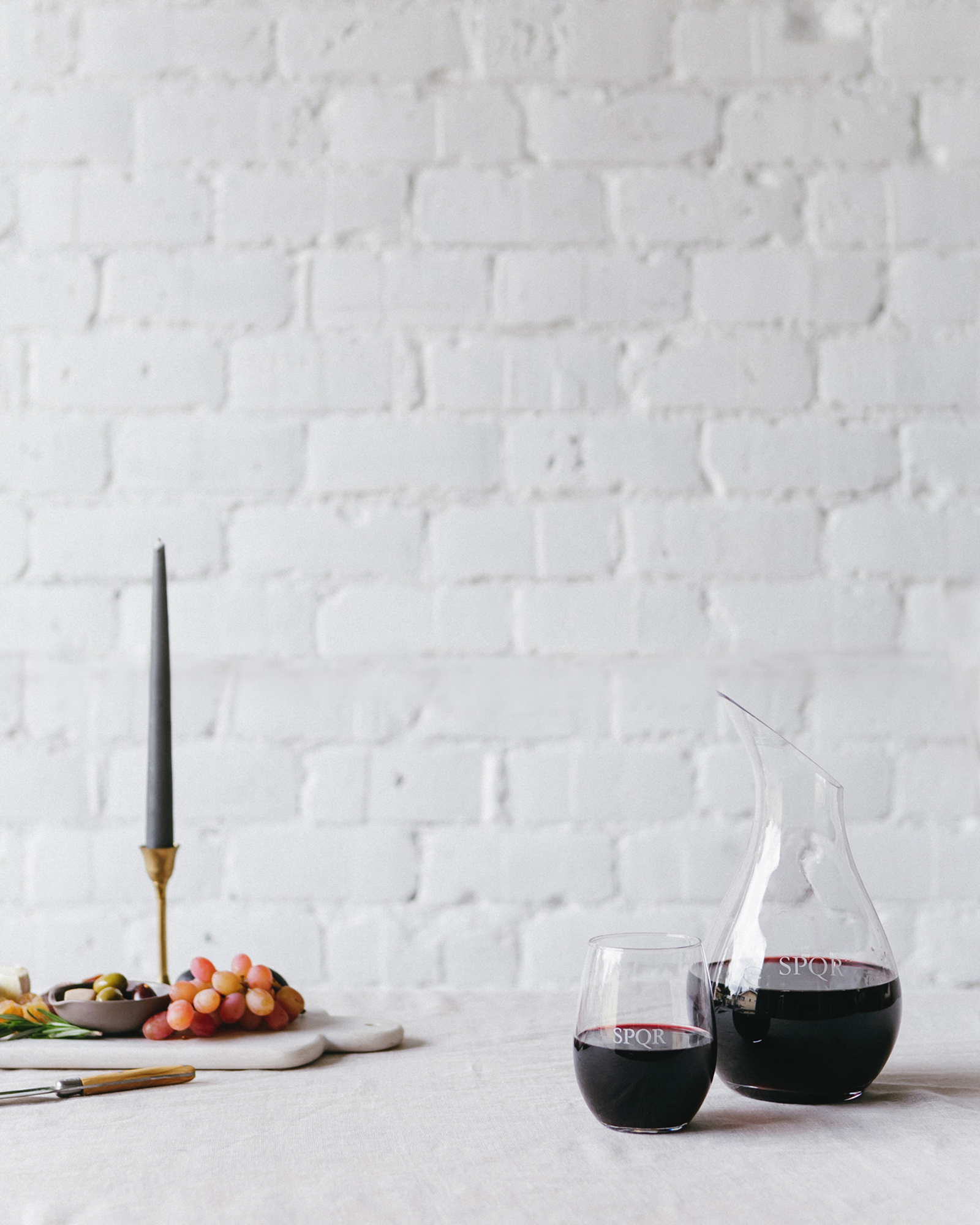 host a wine night inspired by your travels with custom decanters and wine glasses! // anne sage