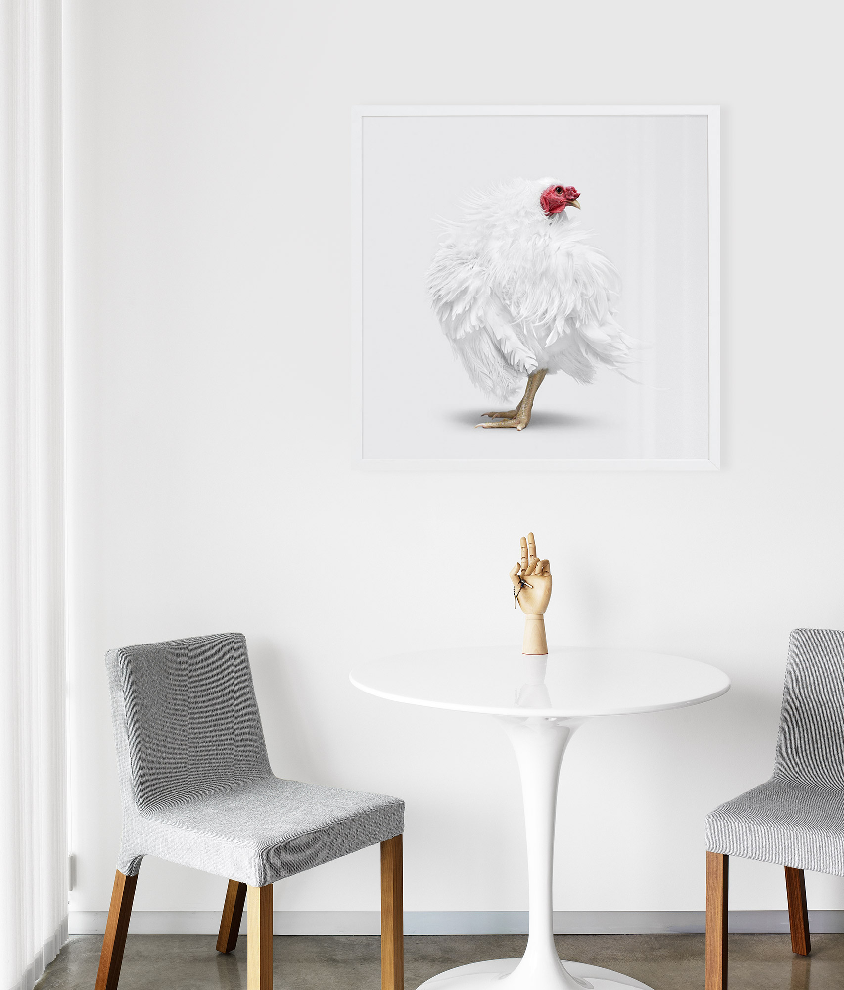simple white dining nook with oversized animal art // anne sage