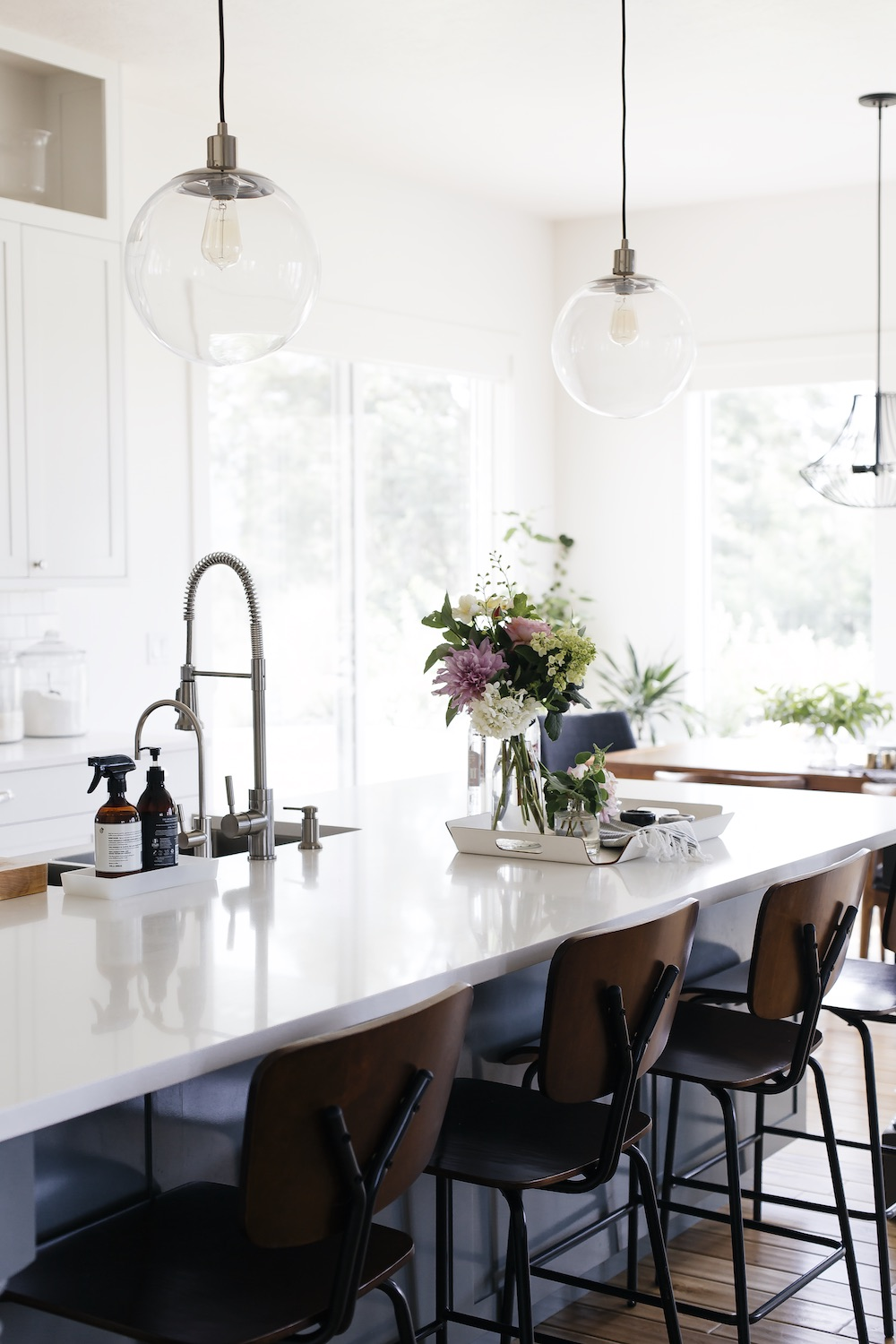 white kitchen with island and industrial stools // anne sage