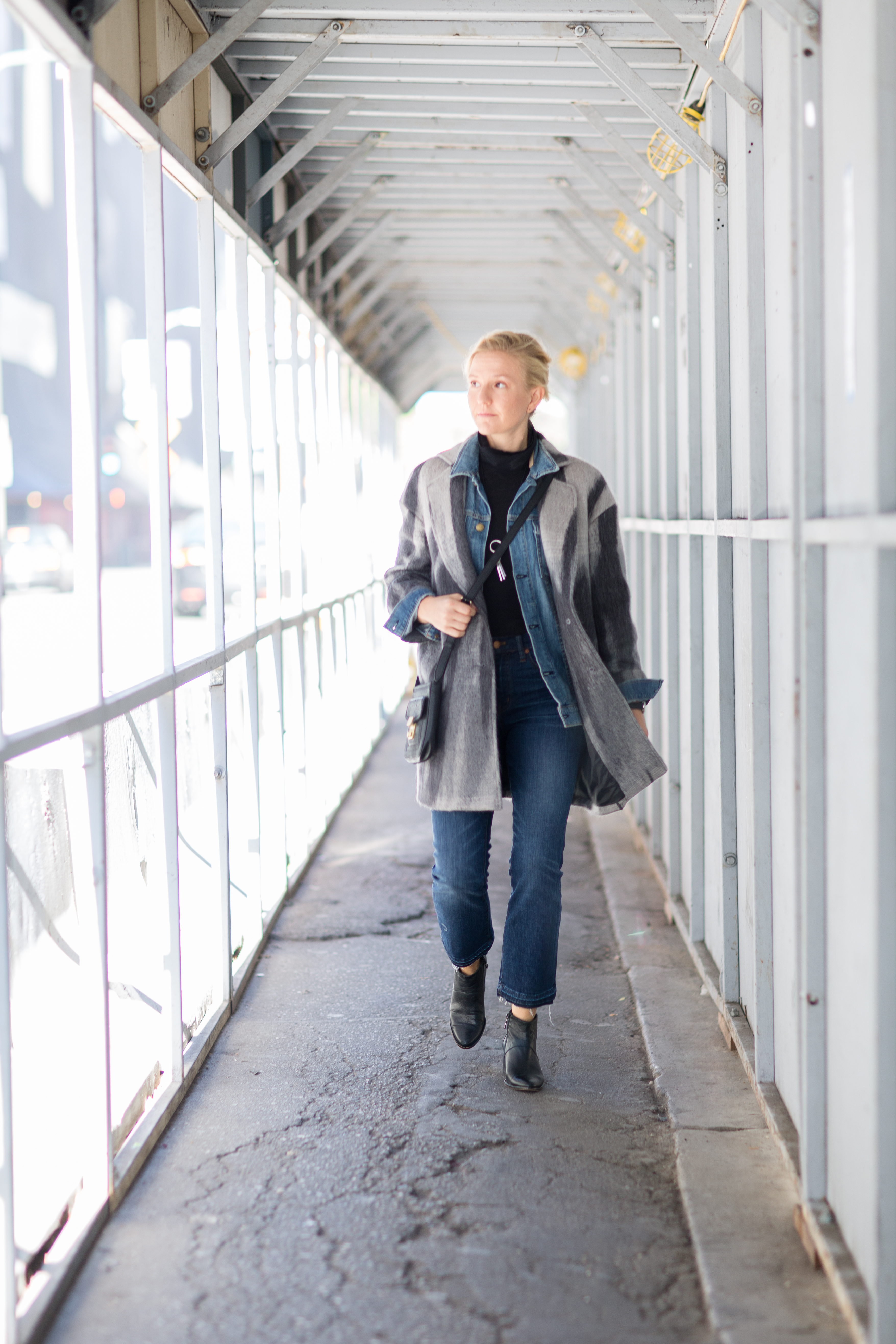 denim jacket under wool coat for stylish winter layers // anne sage