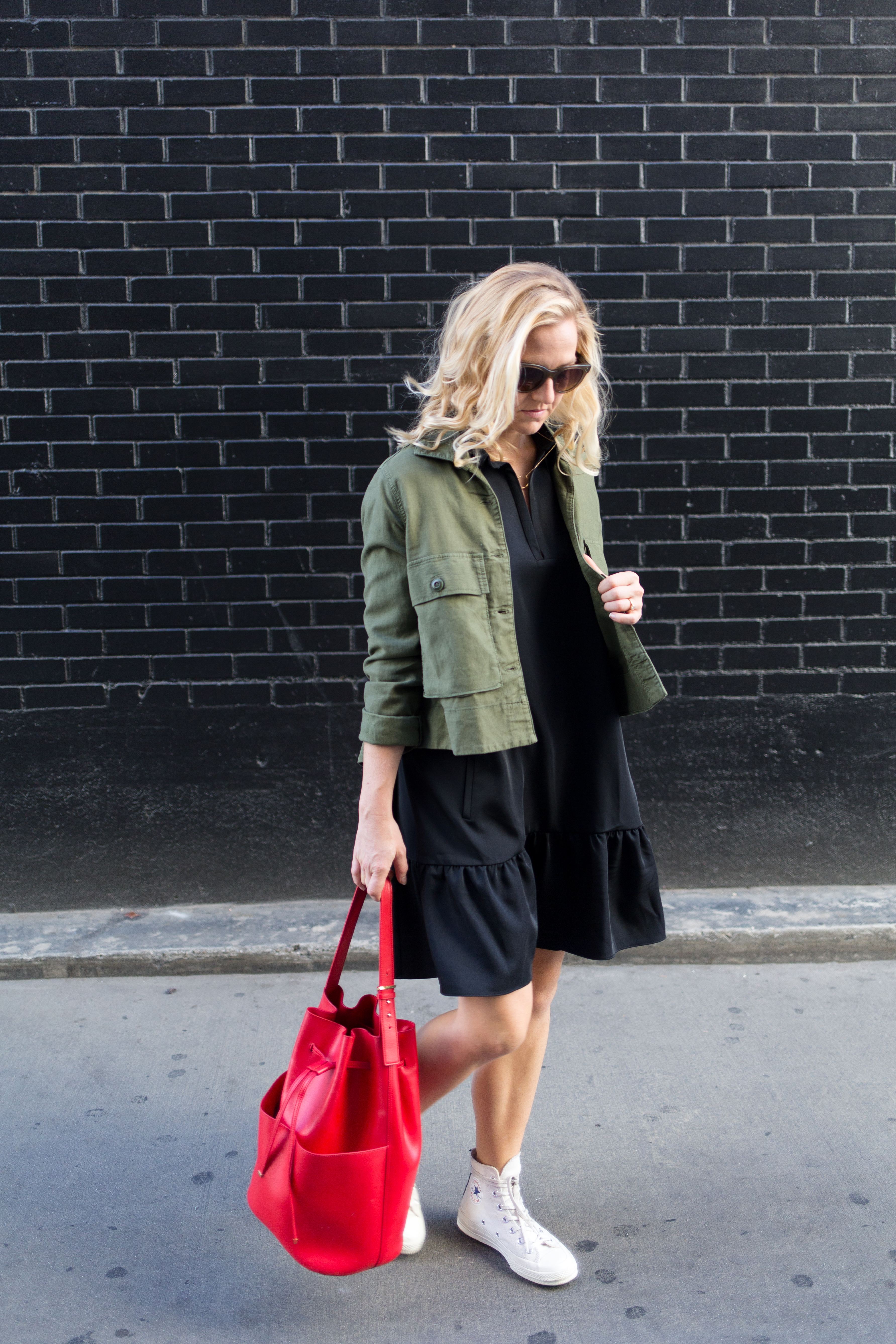 army jacket + ruffled dress with red bucket bag // anne sage