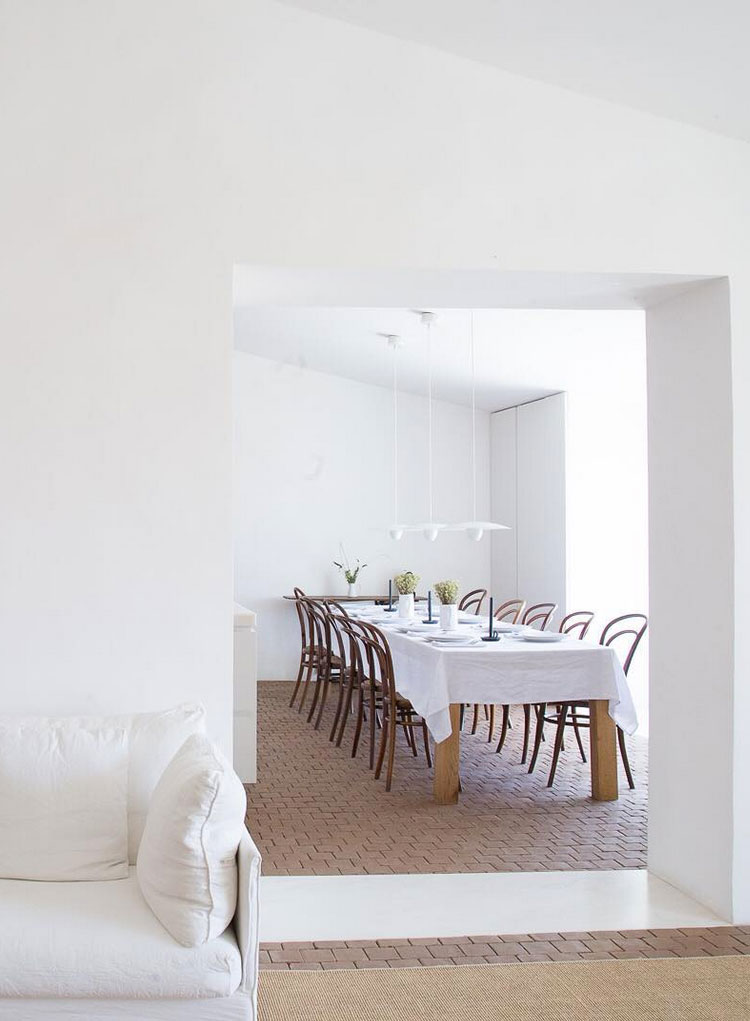 minimalist white living room and dining room with bentwood chairs // anne sage