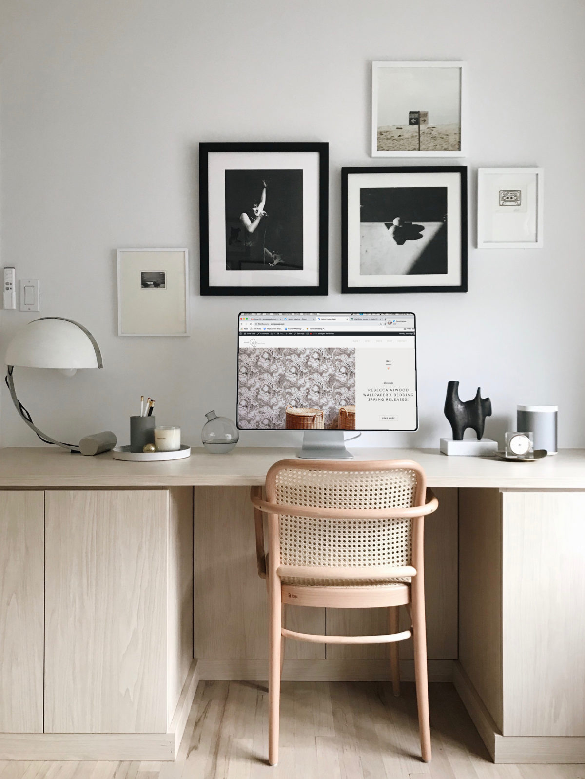 minimalist scandinavian office with woven cane chair