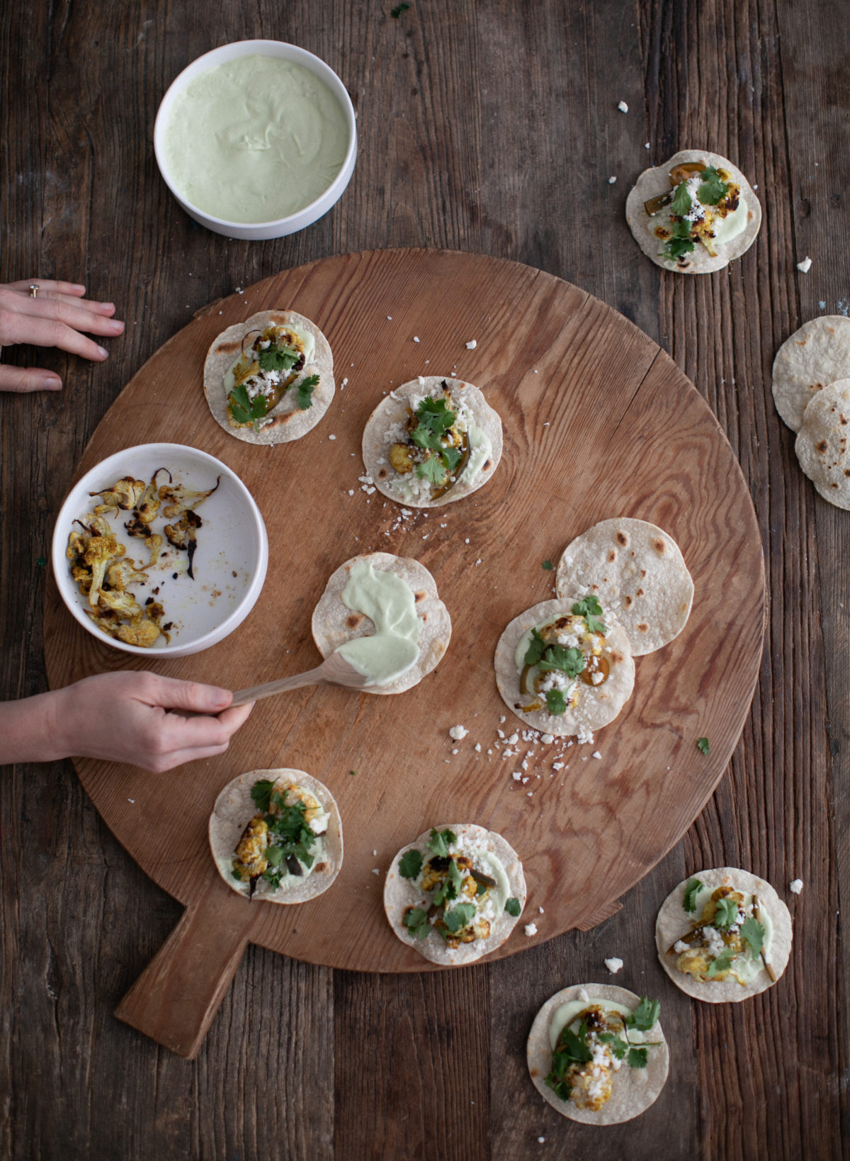 roasted cauliflower vegan tacos with cilantro lime crema