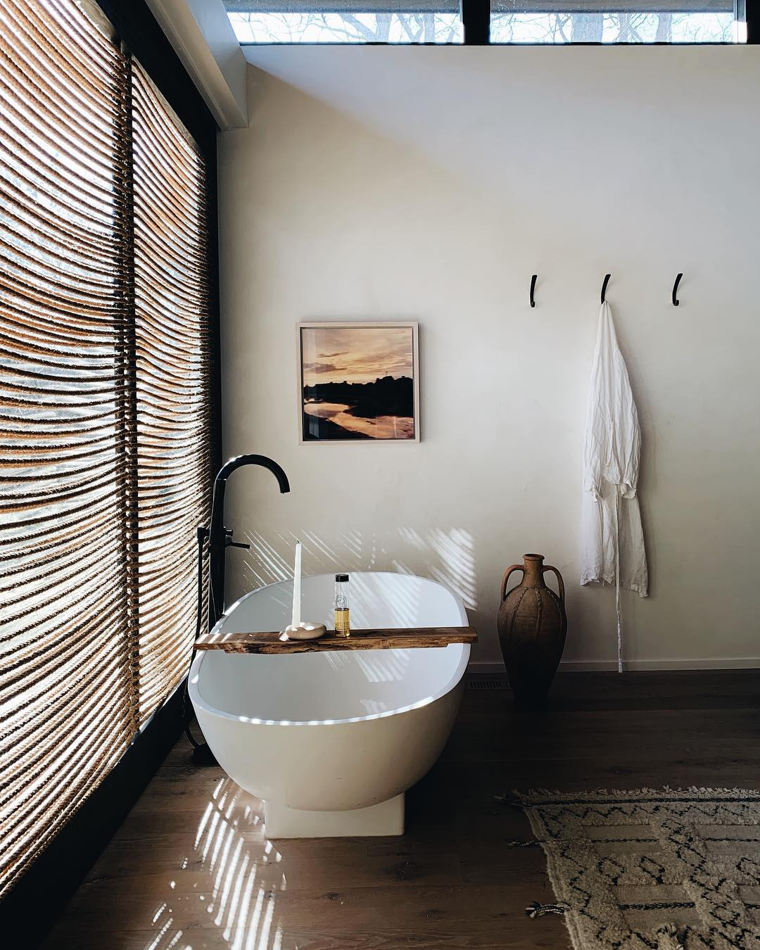 spa bathroom with round freestanding tub