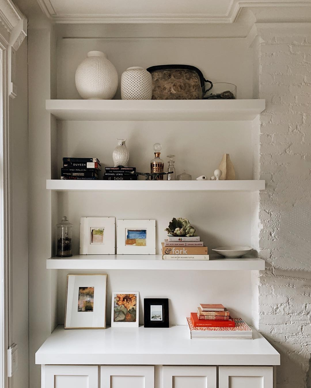 built in bookshelves and how to style open shelving