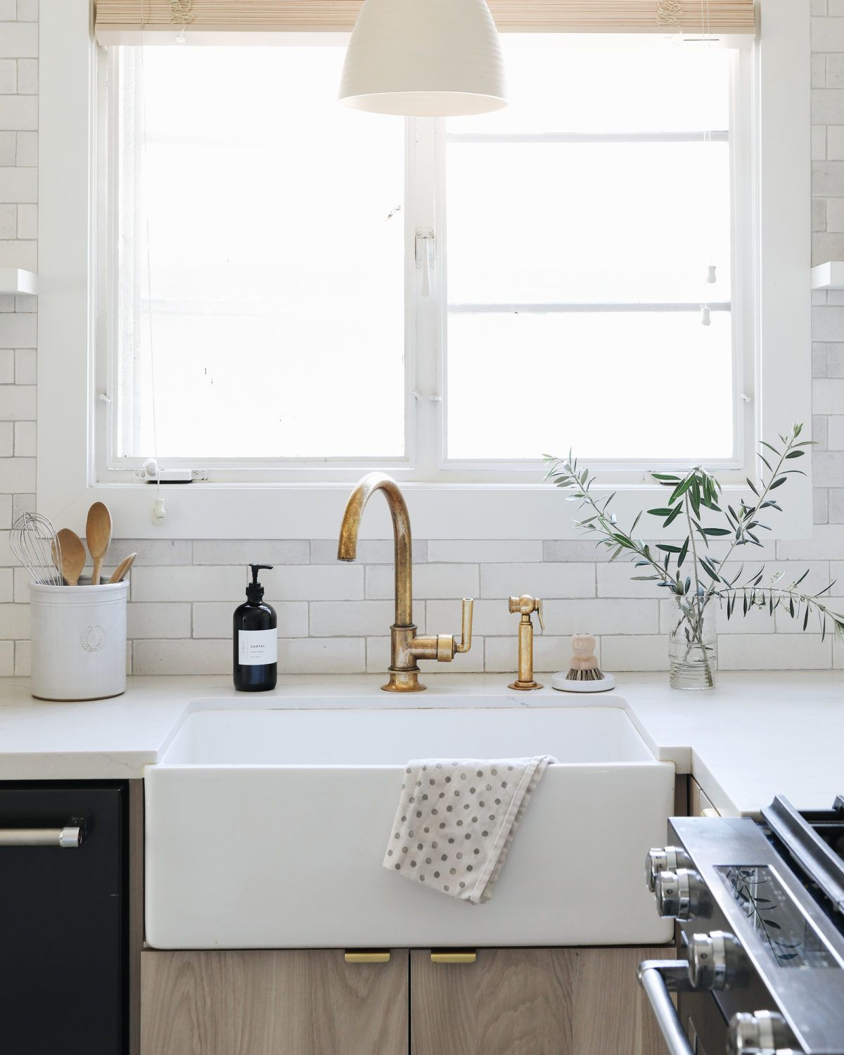 modern farmhouse kitchen with brass faucet