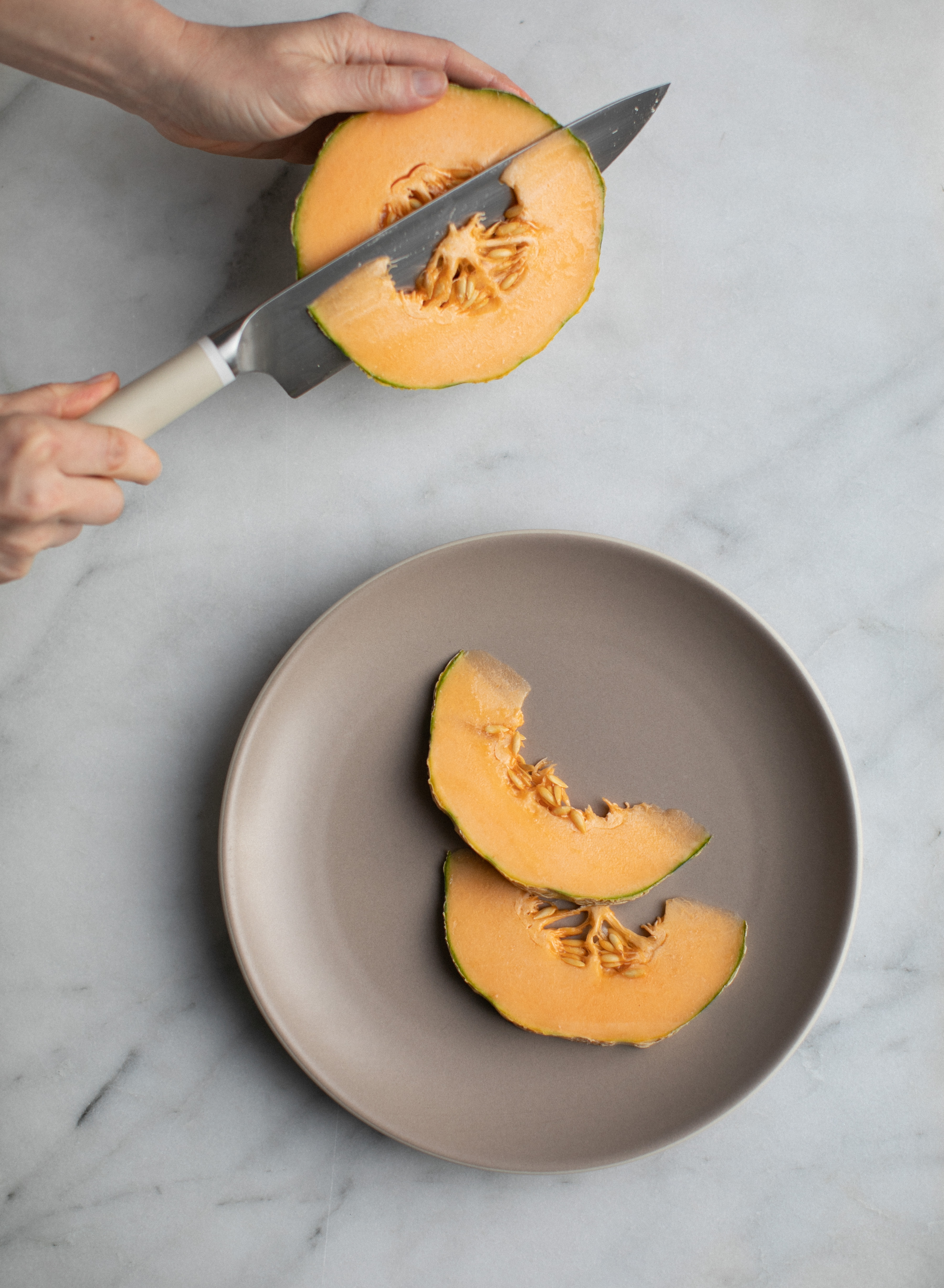 slicing a melon for a fruit plate