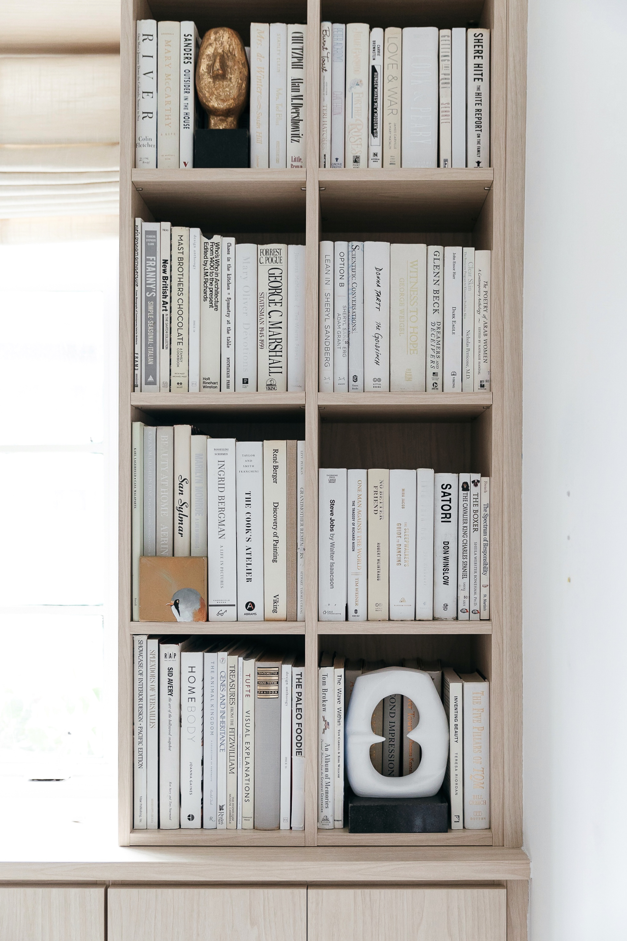 all white books on built-in bookshelves