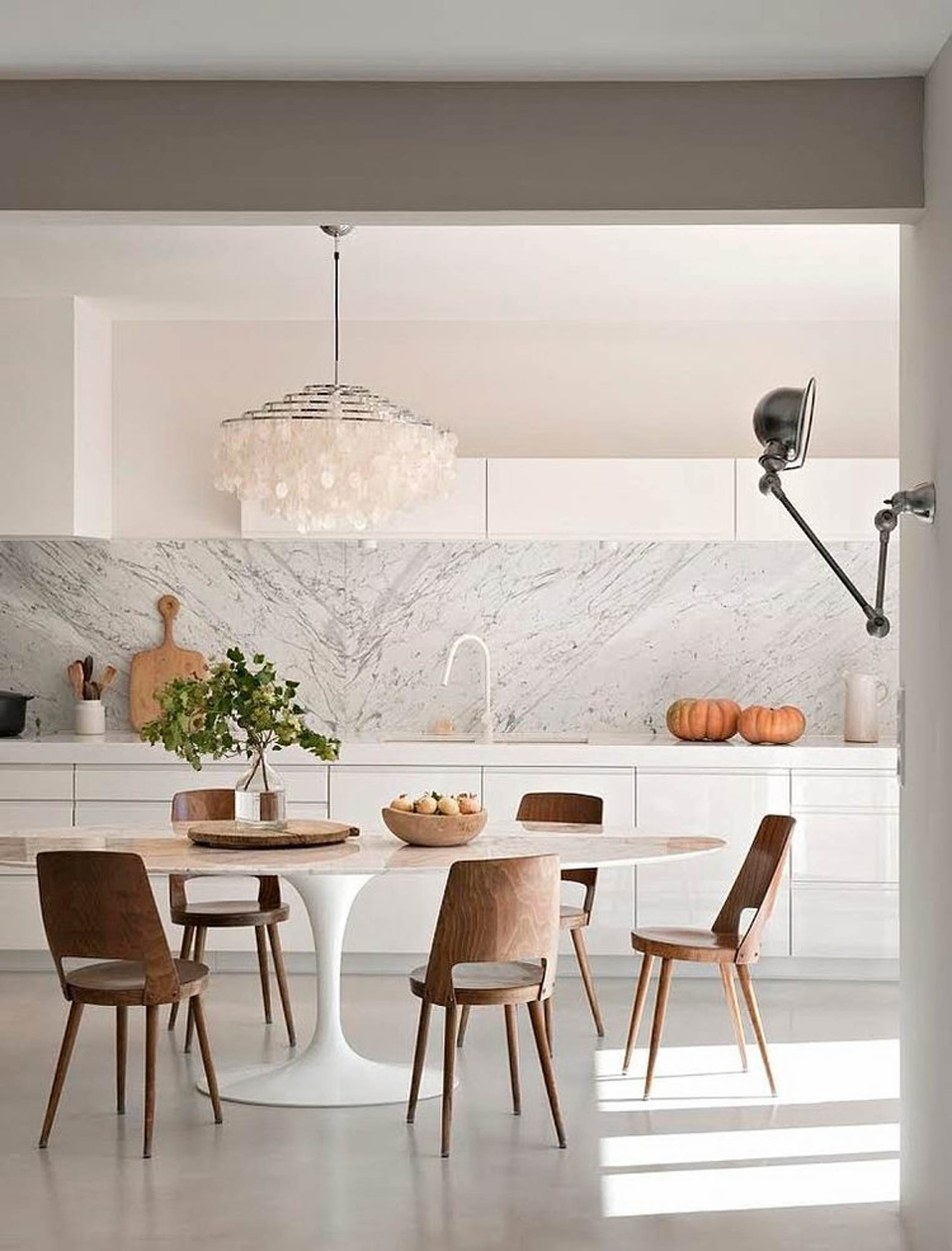 glamorous modern oval tulip table in a modern kitchen