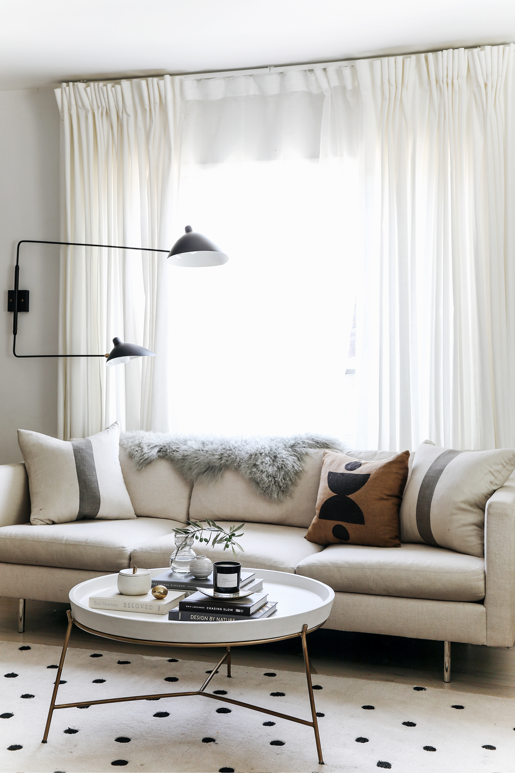sunpan remy coffee table in a neutral modern living room