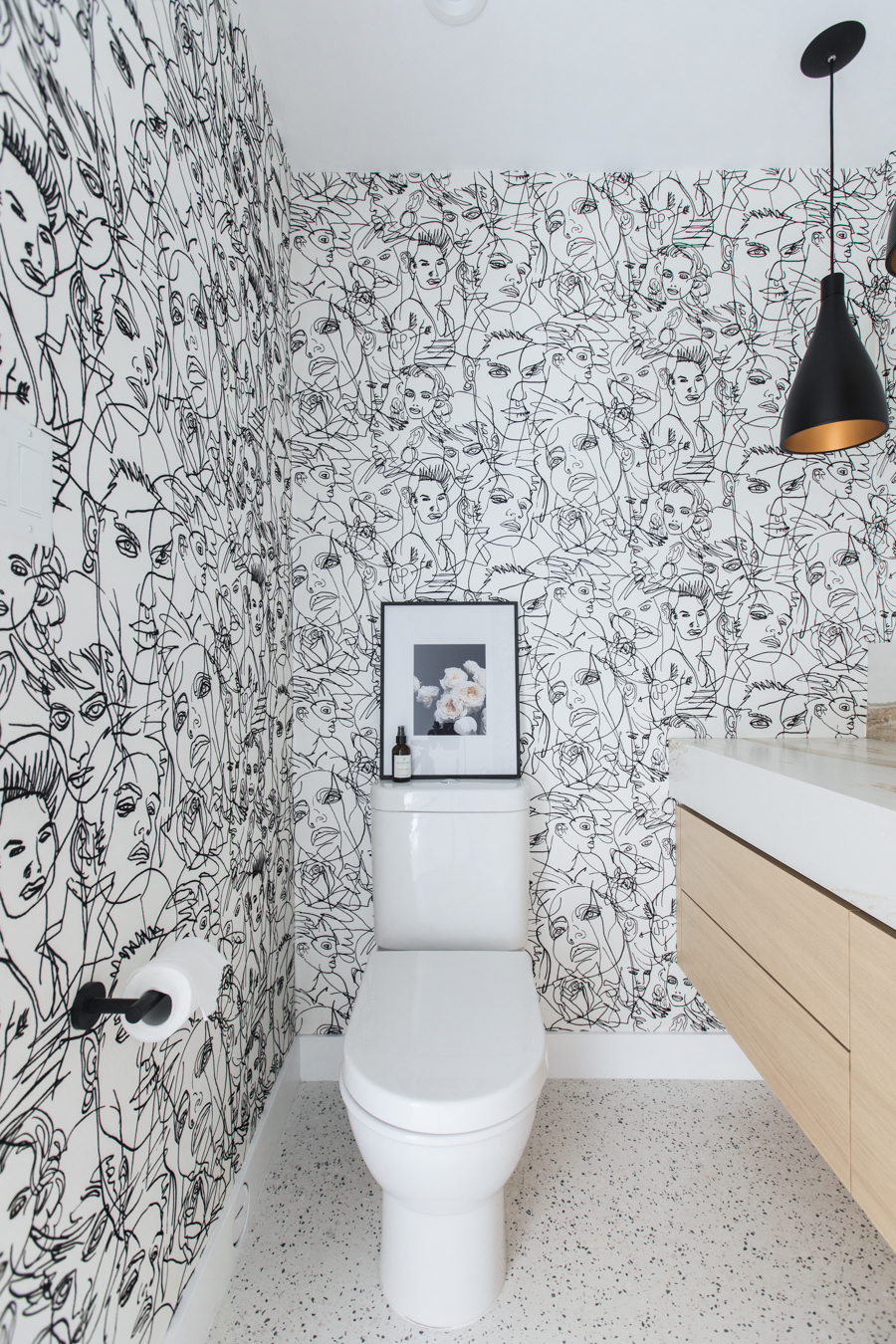 modern bathroom with jean paul gaulthier croquis wallpaper duravit toilet